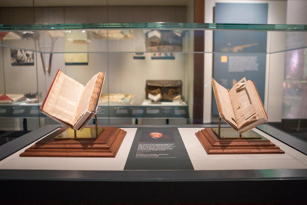 <em>The Life and Morals of Jesus of Nazareth</em>, left, was created by Thomas Jefferson to express his own rational approach to faith. Using a pen knife and glue, Jefferson crafted a condensed version of the New Testament, right, in keeping with the spirit of the Enlightenment.