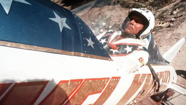 In this Sept. 8, 1974 photo, Evel Knievel sits in the steam powered rocket motorcycle that will hopefully take him across Snake River Canyon in Twin Falls, Idaho.