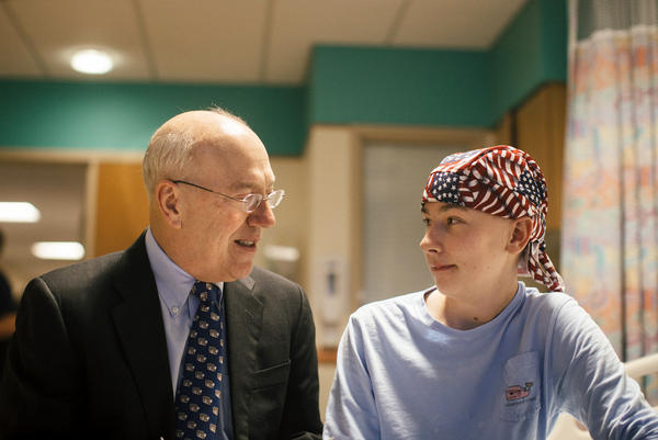 Dr. Kurt Newman visits with 14-year-old Jack Pessaud, who's undergoing treatment for a cancerous tumor in his knee at Children's National Health System in Washington, D.C.