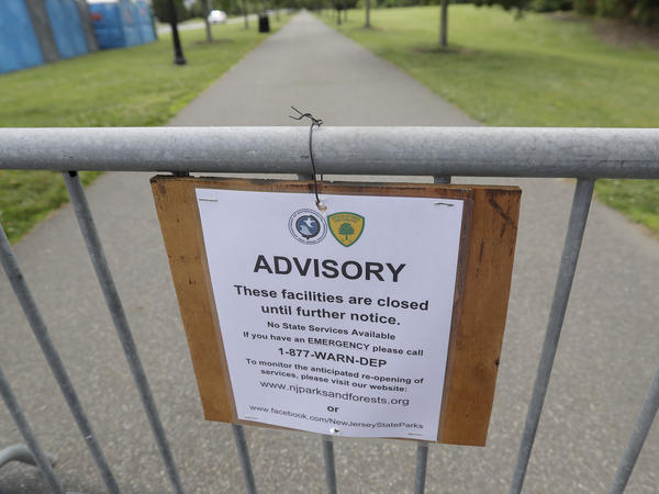 A sign at the barricaded Liberty State Park in Jersey City turns away would-be visitors during the New Jersey government shutdown.