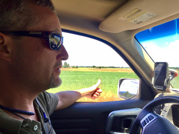 <p>Jason Hunton farms organic and conventional land in Junction City, Oregon. He points out a successful organic wheat crop.</p>