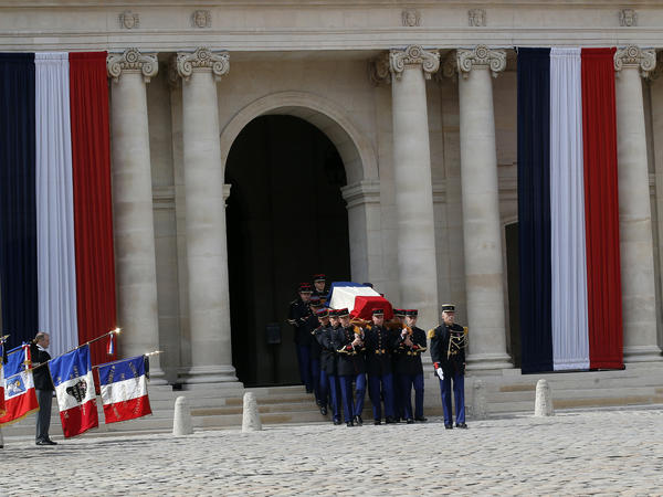 Republican guards carry the flag-draped coffin of Simone Veil during a funeral ceremony in Paris on Wednesday.