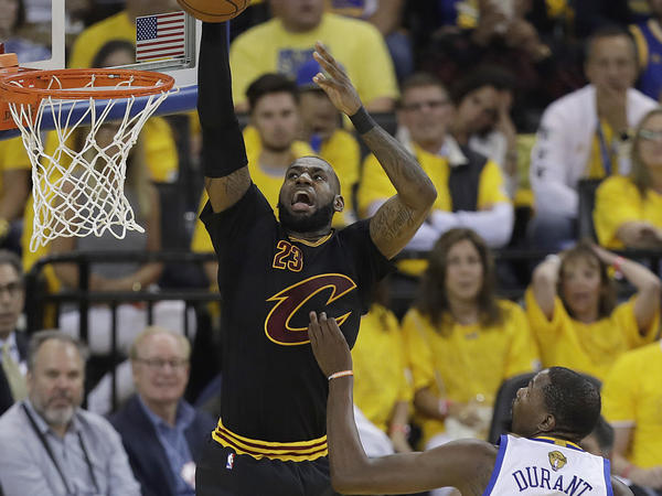 Cleveland Cavaliers forward LeBron James dunks during the NBA Finals in Oakland, Calif., last month. Studies show that star performers are more likely to be undermined by their peers.