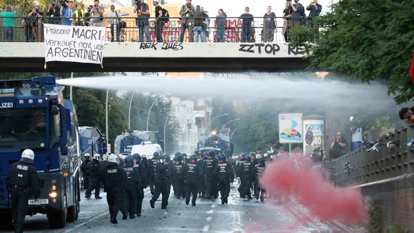 Riot police use a water cannon and pepper spray to disperse protesters on Thursday in Hamburg, Germany, ahead of the Group of 20 summit.