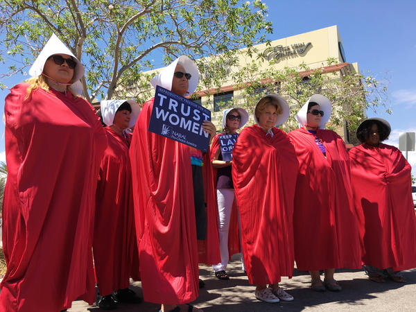 Opponents of the Republican health care proposal protest outside Republican Sen. Dean Heller's office in Nevada.