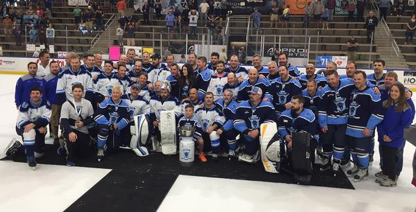 The participants gather for a team photo upon the conclusion of the 11 Day Power Play game.