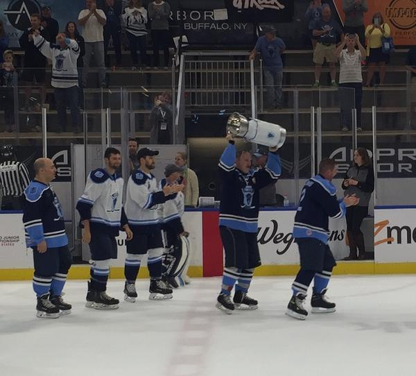Players took turns raising a ceremonial cup, and later drank champagne from it, to celebrate their successful conclusion of the 11 Day Power Play.
