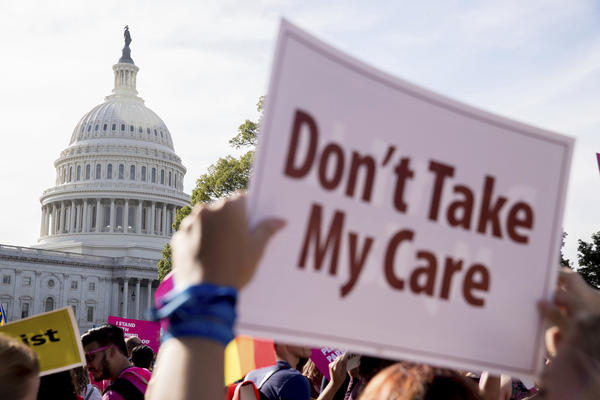 A large group of protesters rally against the Senate Republican healthcare bill on the East Front of the Capitol Building in Washington, Wednesday, June 28, 2017. (Andrew Harnik/AP)
