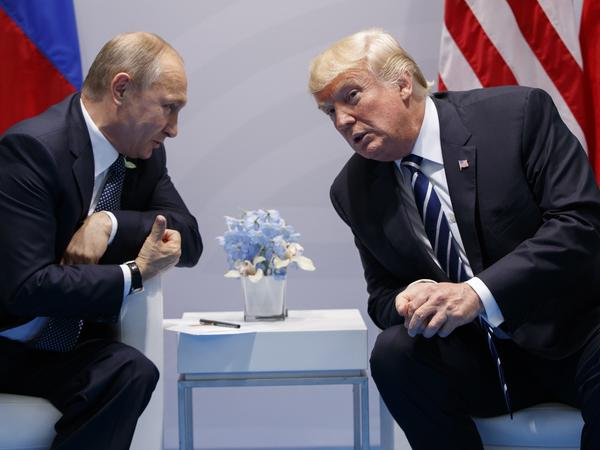 President Trump and Russian President Vladimir Putin at the G-20 Summit on Friday. Shortly after they met, the United States said the two countries had agreed to a cease-fire in southwestern Syria.