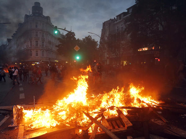 A barricade is set on fire during a protest against the G-20 summit in Hamburg, northern Germany, on Friday.
