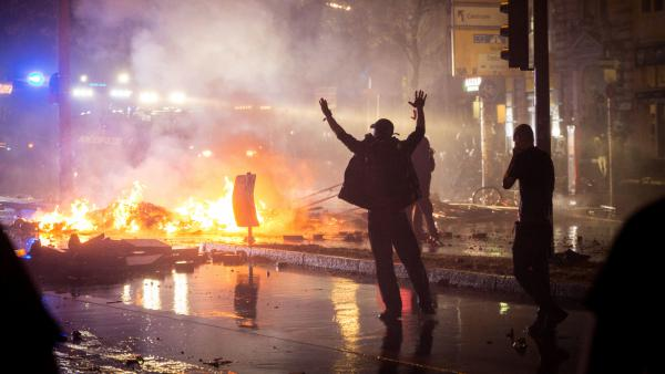 Anti-G-20 Summit protesters set fires during clashes with riot police in Hamburg, Germany, Friday night.