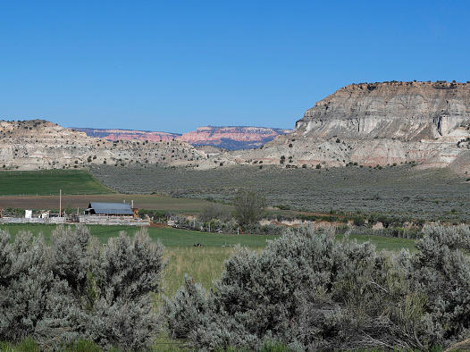 A farm sits at the foot of sandstone formations in the Grand Staircase-Escalante National Monument on May 11, 2017 outside Escalante, Utah.