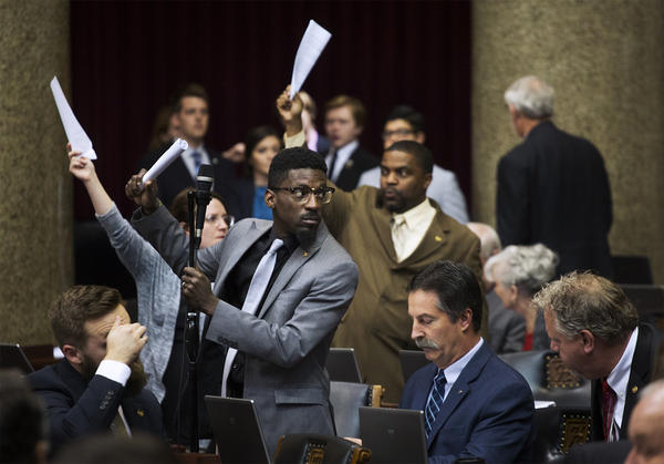 House Democrats, including Rep. Bruce Franks Jr., raise their hands to speak about the $10-an-hour minimum wage in St. Louis.