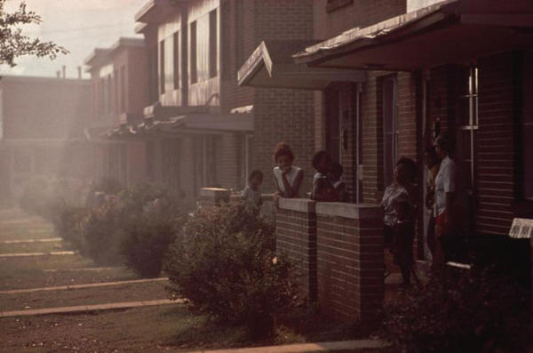 <p>A photo taken in 1972 in Birmingham, Alabama, for the Environmental Protection Agency's Documerica program. The image captures the dense industrial smog in a neighborhood adjacent to a manufacturing plant.</p>