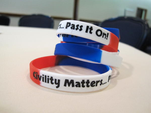 Bracelets were handed out at a NICD civility workshop involving reporters, public officials and citizens in Columbus in 2015.