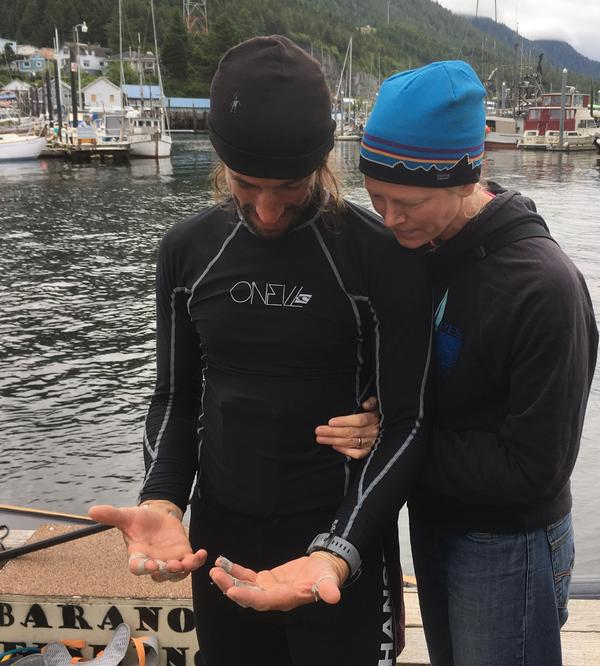 Kruger and his wife Jessica look at his taped-up, blistered hands upon arrival in Ketchikan.