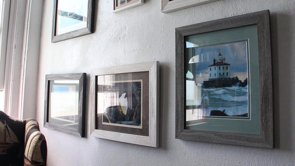 Photos of the lighthouse line the walls