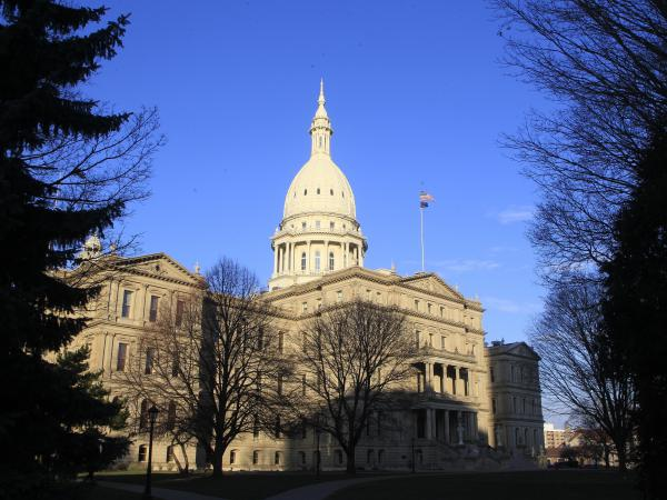 Michigan Gov. Rick Snyder signed legislation on Tuesday creating harsher penalties for doctors, parents and others convicted of female genital mutilation. Above, the state Capitol in Lansing in 2012.