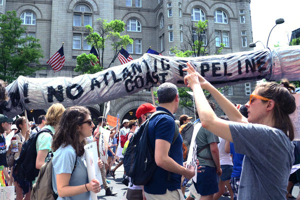 A mock pipeline, carried by Virginia college students at the People's Climate March in Washington, D.C., at the end of April, protests the proposed Atlantic Coast pipeline.