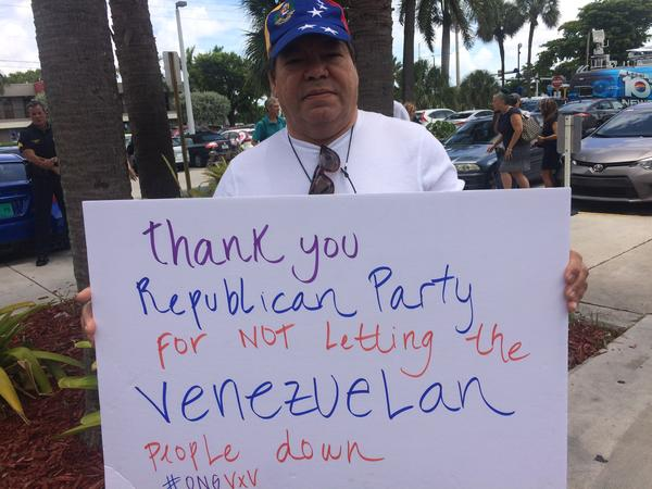 A Venezuelan man holds a sign he made for the rally