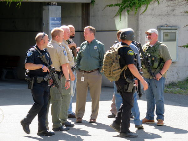 Heavily armed officers swarmed the Washington State Capitol Campus on Wednesday after an unconfirmed report of gunshots.