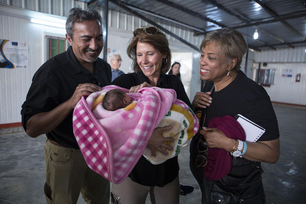 at a maternity hospital for Syrian refugees in Jordan, Bustos is flanked by Rep. Ami Bera (Ca.) and Rep. Brenda Lawrence (Mich.)