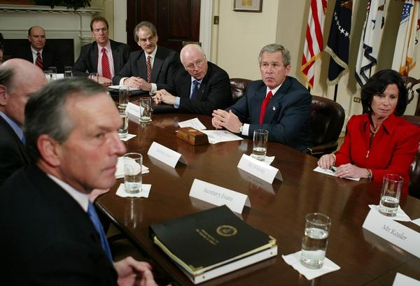 President Bush listens to a reporter's question after meeting with economists, Friday, Jan. 30, 2004, in the Roosevelt Room of the White House. Former Medicaid director Gail Wilensky is pictured at the right. (Ron Edmonds/AP)