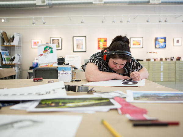Jamila Rahimi works at Art Enables on a Monday afternoon. Rahimi, who has been working at the studio since 2006, creates the structure of her drawings with permanent marker before adding color.