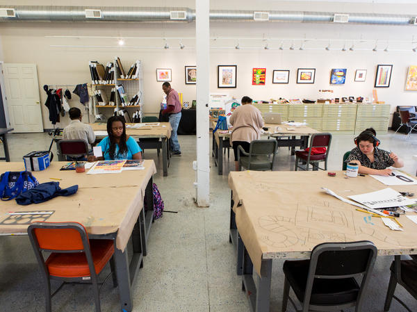 Artists work in the Art Enables studio and gallery in Northeast Washington, D.C., on a Monday afternoon in June.