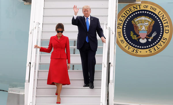 President Trump and first lady Melania Arrive At Orly Airport on Thursday in Paris. Trump told reporters on Air Force One that he was considering tariffs on steel imports.
