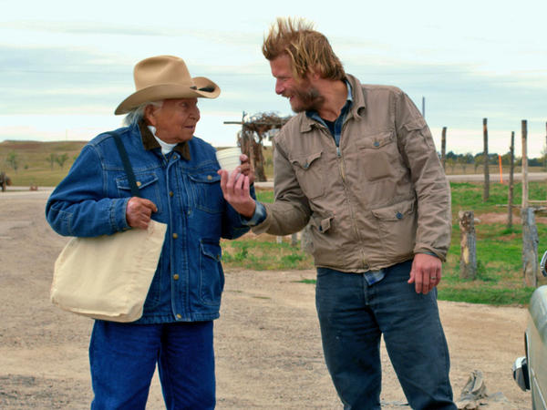 In ''Neither Wolf Nor Dog,'' Christopher Sweeney, right, as a book author who is trying to write the story of a Lakota elder.