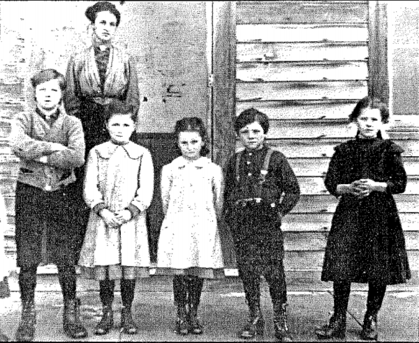 These students attended the Pere Cheney School around 1910. Their teacher stands behind them.