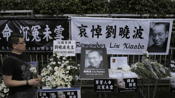 A man mourns late Chinese Nobel Peace laureate Liu Xiaobo outside the Chinese liaison office in Hong Kong.
