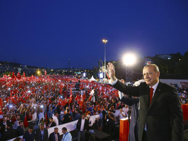 Turkey's President Recep Tayyip Erdogan waves to his supporters as he arrives to commemorate the one year anniversary of the July 15, 2016 failed coup attempt, in Istanbul, Saturday.
