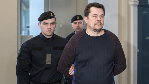 Evaldas Rimasauskas walks into court in May in Vilnius, Lithuania. On Monday, the court ruled the man allegedly behind a massive email scheme must be extradited to the U.S. to stand trial.