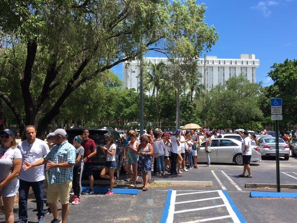 Long lines and high temperatures didn't dampen the spirits of those waiting outside the University of Miami's Watsco Center.
