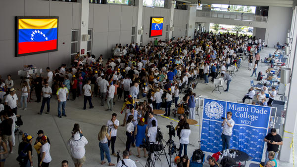 Venezuelan voters wait in line at the Miami Dade College West campus in Doral.