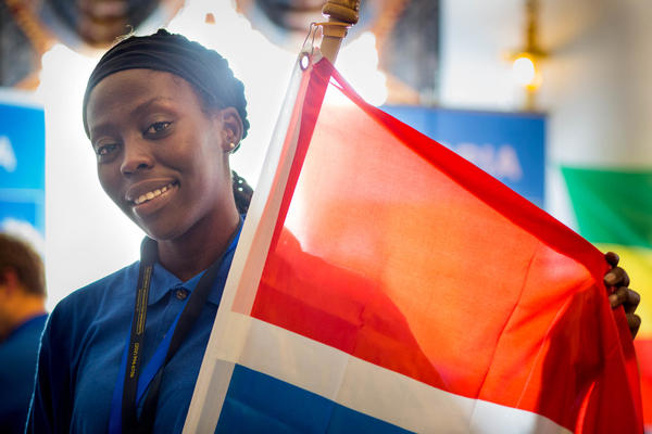 Fatoumata Ceesay of team Gambia displays her country's flag at the First Global Challenge.