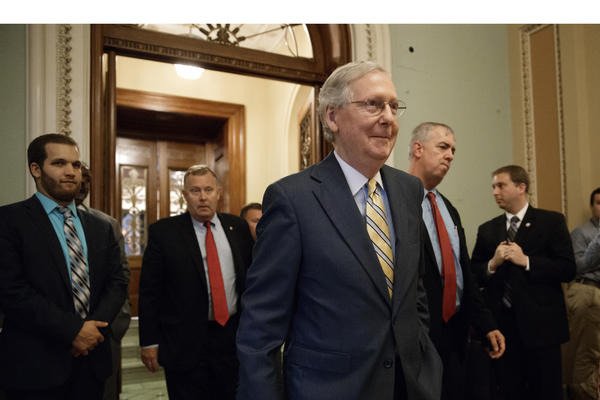 Senate Majority Leader Mitch McConnell of Ky. leaves the Senate chamber on Capitol Hill in Washington, Thursday, July 13, 2017, after announcing the revised version of the Republican health care bill. (J. Scott Applewhite/AP)