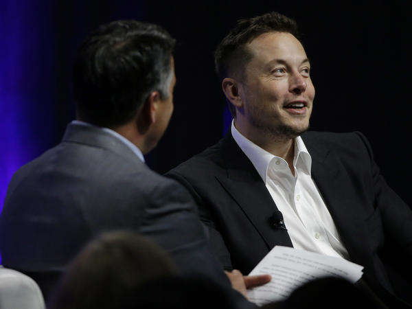 Artificial intelligence poses an existential risk to human civilization, Elon Musk (right) told the National Governors Association meeting Saturday in Providence, R.I.