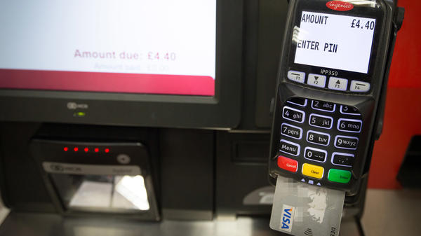 Britain's new rule seeks to prevent steep fees — as much as 20 percent — from being added to customers' bills simply because they pay with a credit card rather than with cash.