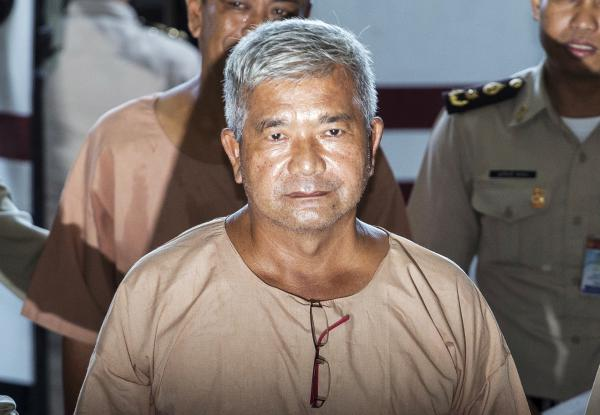 Lt. Gen. Manas Kongpan was found guilty of trafficking and taking bribes, The Associated Press reported.