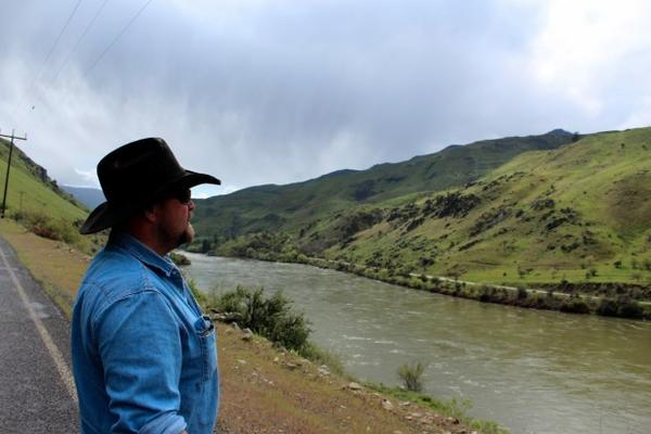 <p>Rancher Chad DelCurto stands at the banks of the Snake River, surveying the stretch of public land where his cattle graze. DelCurto saidhe lost 41 calves and 11 cows last year, and he blames wolves.</p>