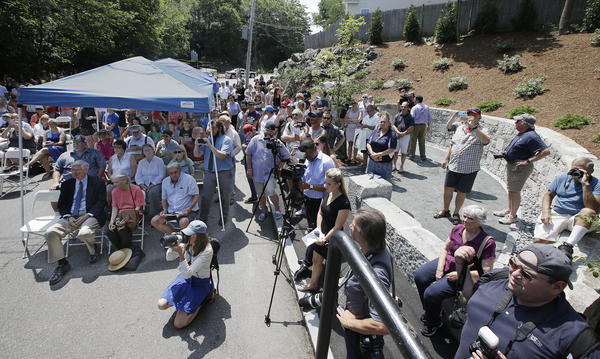 Wednesday's dedication of a memorial honoring those executed during the Salem witch trials draws a crowd to where researchers say was the site of the hangings.