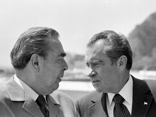 Soviet Communist Party leader Leonid Brezhnev and U.S. President Richard Nixon walk around the grounds of Brezhnev's country home by the Black Sea in Yalta, Russia, in June 1974. Nixon had some meetings with Brezhnev without a U.S. interpreter, a practice that can lead to problems.