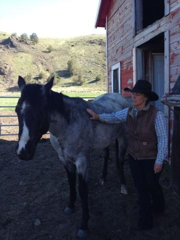 <p>Liza Jane and her horse, Fly. She and her daughter, Adele, use horses to move their cows to different areas of the ranch to prevent overgrazing.</p>