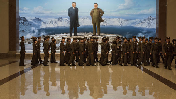 The U.S. is planning to ban American citizens from traveling to North Korea, tourism companies say. Earlier this week, Korean People's Army soldiers walked past portraits of late North Korean leaders Kim Il Sung (left) and Kim Jong Il at the Korean Revolutionary Museum in Pyongyang.