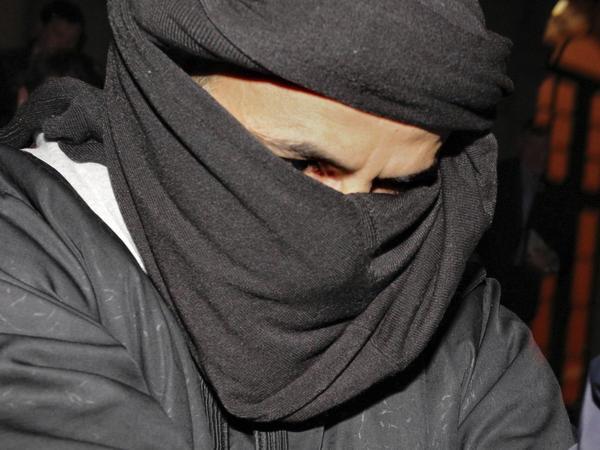"Ali Charaf Damache, known as ""Black Flag,"" arrives at the courthouse in Waterford, Ireland, in 2010. Damache appeared in a Philadelphia federal courtroom Friday on terrorism-related charges."