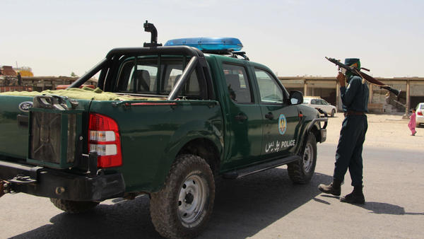 An Afghan policeman holds a rocket-propelled grenade during an ongoing battle with Taliban militants in the Gereshk district of Helmand province Saturday. A U.S. airstrike killed 16 policemen in the area on Friday, local officials said.