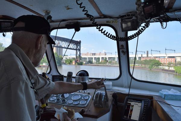 Captain Wayne Bratton steers the ship out of the Cuyahoga River